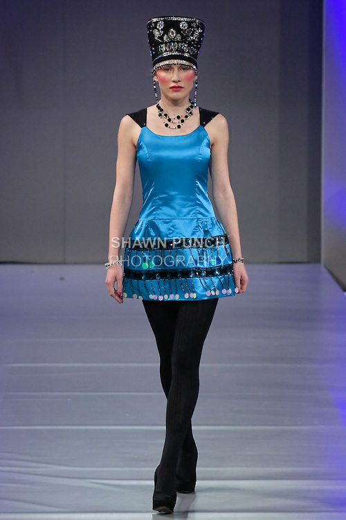 Model walks the runway in an outfit by Evgenia Luzhina-Salazar for her fashion show, during Couture Fashion Week Spring 2012.
