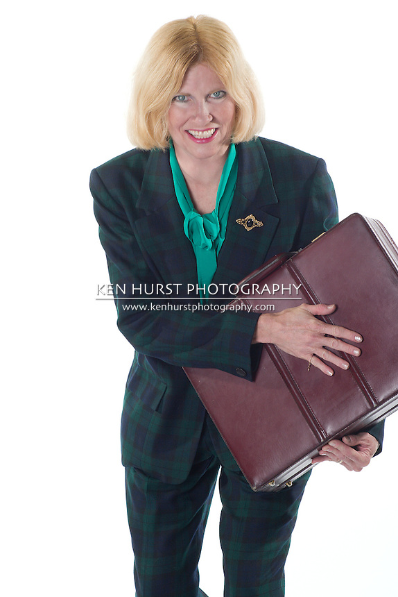 attractive business woman clutching her briefcase with both hands to protect it.