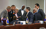 Nevada Senate Democrats caucus on the Senate floor at the Legislative Building in Carson City, Nev., on Wednesday, April 15, 2015. <br /> Photo by Cathleen Allison