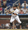 Ichiro Suzuki (Marlins),<br /> APRIL 8, 2015 - MLB :<br /> Ichiro Suzuki of the Miami Marlins bunts for a single in the seventh inning during the Major League Baseball game against the Atlanta Braves at Marlins Park in Miami, Florida, United States. (Photo by AFLO)