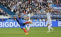Gary Cahill (Chelsea) of England raises his hand as Olivier Giroud (Arsenal) of Franceputs the ball in the ball which is disallowed for offside during the International Friendly match between France and England at Stade de France, Paris, France on 13 June 2017. Photo by David Horn/PRiME Media Images.