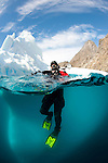 Diver in front of an iceberg, Astrolabe Island, Antarctic peninsula