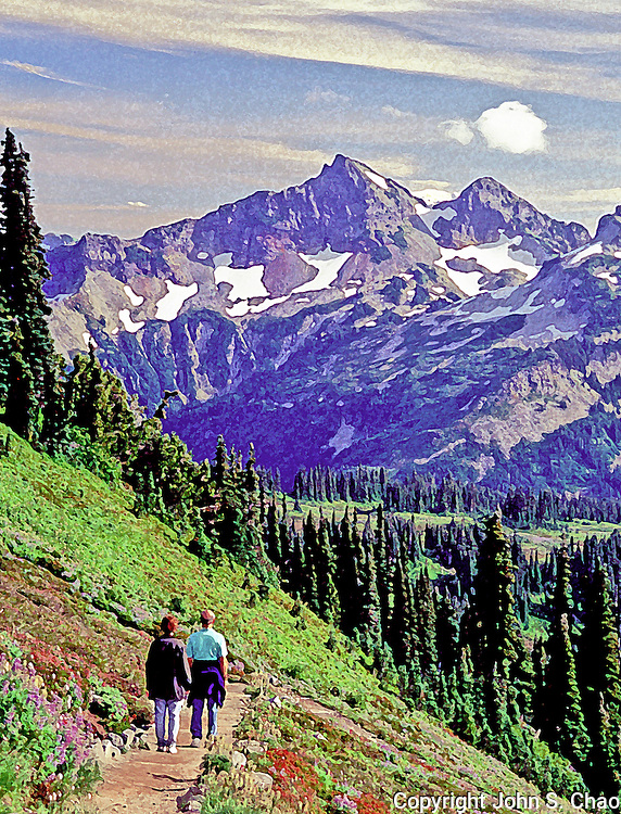 Couple hiking Skyline Trail viewing Stevens and Unicorn Peaks in Mt. Rainier National Park, Washington State. Photo adjusted with Photoshop Dry Brush filter.
