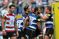 Max Clark of Bath Rugby is congratulated on his try. West Country Challenge Cup match, between Gloucester Rugby and Bath Rugby on September 13, 2015 at the Memorial Stadium in Bristol, England. Photo by: Patrick Khachfe / Onside Images