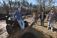 NWA Democrat-Gazette/FLIP PUTTHOFF <br /> Riders chat with Bub Pearson (left) Dec. 21 2018 at Pearson's back-country cabin off the beaten path in rural Johnson County.