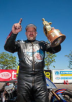 Apr 14, 2019; Baytown, TX, USA; NHRA top fuel Harley Davidson nitro motorcycle rider Jay Turner celebrates after winning the Springnationals at Houston Raceway Park. Mandatory Credit: Mark J. Rebilas-USA TODAY Sports