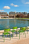 Green chairs surround a large fountain in the Tuileries Gardens; Jardin des Tuileries Paris France