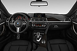 Stock photo of straight dashboard view of 2020 BMW 4-Series 440i-M-Sport Door Coupe Dashboard