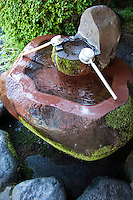 Water is considered purifying in Japan, hence the emphasis on cleanliness in everyday life.  Water fountains such as these, known as tsukubai, are also beneficial to hear the trickling of falling water to soothe the nerves as well.  A tsukubai is a small basin provided at Japanese Buddhist temples for visitors to purify themselves by the ritual washing of hands and rinsing of the mouth. This type of ritual cleansing is also the custom for guests attending a tea ceremony.<br /> Tsukubai are usually of stone, and are often provided with a small scoop, laid across the top, ready for use.