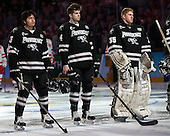 John Gilmour (PC - 3), Mark Adams (PC - 4), Nick Ellis (PC - 35) - The Providence College Friars defeated the Boston University Terriers 4-3 to win the national championship in the Frozen Four final at TD Garden on Saturday, April 11, 2015, in Boston, Massachusetts.