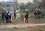"""Israeli soldiers secure the scene after a Palestinian man who tried to stab an Israeli soldier before being shot dead, at the Bitot Junction south of Nablus in the northern occupied West Bank, on February 21, 2016. """"A Palestinian attacker attempted to stab an (Israeli) soldier at the Bitot Junction,"""" the Israeli army said. """"The force responded to the imminent danger, thwarting the attack and firing towards the assailant, resulting in his death."""" Palestinian security sources spoke of gunfire targeting a Palestinian in the area. Photo by Nedal Eshtayah"""