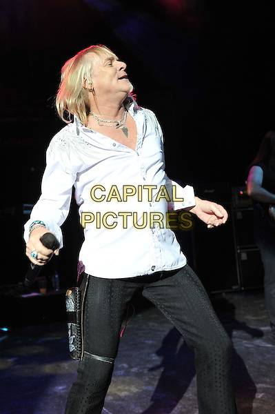 Bernie Shaw.Uriah Heep performing live in concert, Shepherd's Bush Empire, London, England. .8th December 2011.on stage gig performance music half length white shirt side profile jeans denim black .CAP/MAR.© Martin Harris/Capital Pictures.