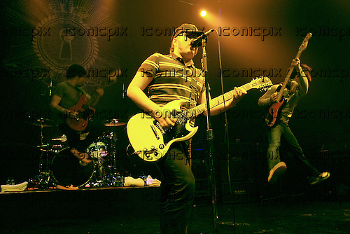 FALL OUT BOY - L-R: Joe Trohman, Patrick Stump, Pete Wentz - performing live at the Astoria in London UK - 30 Jan 2006.  Photo credit: George Chin/IconicPix