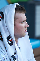Charlotte Knights starting pitcher Spencer Adams (18) tries to stay cool between innings of the game against the Toledo Mud Hens at BB&T BallPark on June 22, 2018 in Charlotte, North Carolina. The Mud Hens defeated the Knights 4-0.  (Brian Westerholt/Four Seam Images)