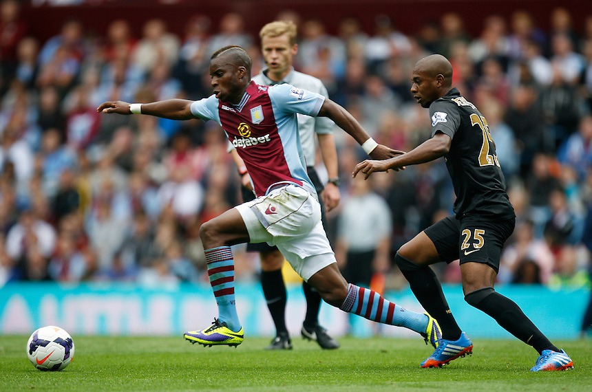 Aston Villa's Yacouba Sylla (L) and Manchester City's Fernandinho in action during todays match  <br /> <br /> Photo by Jack Phillips/CameraSport<br /> <br /> Football - Barclays Premiership - Aston Villa v Manchester City - Saturday 28th September 2013 - Villa Park - Birmingham<br /> <br /> &copy; CameraSport - 43 Linden Ave. Countesthorpe. Leicester. England. LE8 5PG - Tel: +44 (0) 116 277 4147 - admin@camerasport.com - www.camerasport.com