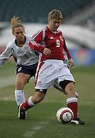 06 November,  2004.  Denmark's Lene Jensen (9) keeps possesion of the ball away from USWNT defender Christie Rampone (3) at  Lincoln Financial Field in Philadelphia, Pa.