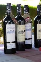bottles of wine for tasting outside chateau le bourdillot graves bordeaux france