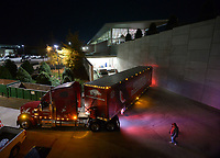 NWA Democrat-Gazette/ANDY SHUPE<br />Rodney Collins (right) of Pensacola, Fla., helps coworker Jerry Rico of Fayetteville Thursday, Nov. 9, 2017, as they drive a semi-truck and 53-foot semi-trailer away from the Fred Smith Football Center before heading out to Baton Rouge, La., ahead of the Razorbacks' game with LSU Saturday. Rico and Collins are employees of J.B. Hunt Transport and the work together to drive equipment necessary for the Razorbacks football team to and from games away from Fayetteville.