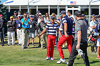 Rickie Fowler (USA) wishes Dustin Johnson (USA) well as Johnson departs the first tee during round 4 Singles of the 2017 President's Cup, Liberty National Golf Club, Jersey City, New Jersey, USA. 10/1/2017. <br /> Picture: Golffile | Ken Murray<br /> <br /> All photo usage must carry mandatory copyright credit (&copy; Golffile | Ken Murray)