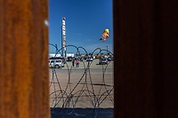 """MEXICALI, MEXICO - April 5 """"Baby Trump"""" Balloon is seen thru the border fence floating in the protest against the President of the United States on April 5, 2019 in Mexicali, Mexico.<br /> President Trump on Friday visited Calexico, a small city in a largely agricultural region between Arizona and the Pacific, to inspect an upgraded portion of fencing and to meet with law enforcement. That's more attention than usual for a border town that locals say is defined by its interconnection with Mexico, its infernal summers and its labor-based economy. <br /> (Photo by Luis Boza/VIEWpress)"""