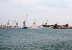 Cranes loading bulk carrier ship with rock ore at the port of Beni Ansar, Morocco, north Africa