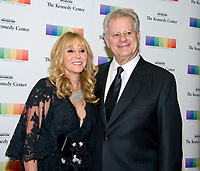 Natural gas billionaire Michael S Smith and his wife, Iris, arrive for the formal Artist's Dinner honoring the recipients of the 40th Annual Kennedy Center Honors hosted by United States Secretary of State Rex Tillerson at the US Department of State in Washington, D.C. on Saturday, December 2, 2017. The 2017 honorees are: American dancer and choreographer Carmen de Lavallade; Cuban American singer-songwriter and actress Gloria Estefan; American hip hop artist and entertainment icon LL COOL J; American television writer and producer Norman Lear; and American musician and record producer Lionel Richie. Photo Credit: Ron Sachs/CNP/AdMedia
