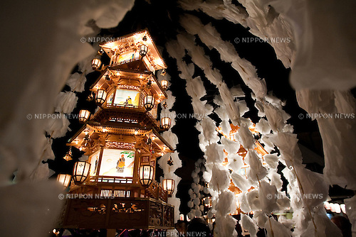 Nov 12, 2009 - Tokyo, Japan - Japanese men, women and children participate in the O-eshiki Festival at Joenji Temple which consist of 'manto-gyoretsu,' a parade with 16 decorated paper cherry blossoms lanterns. O-Eshiki is a Buddhist festival celebrating Saint Nichiren, who passed away in Ikegami on October 13,1282.