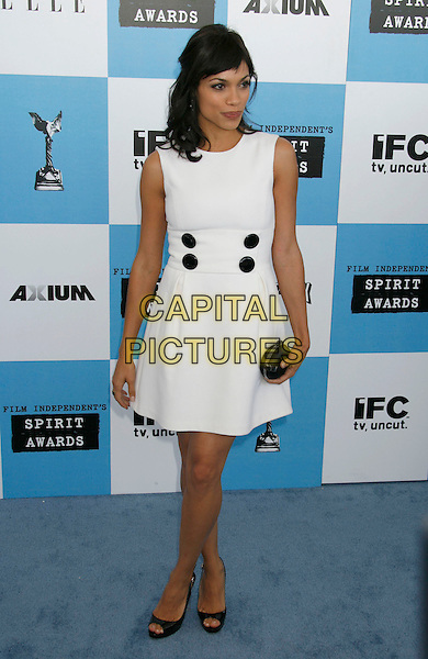 ROSARIO DAWSON.The 2007 Independent Spirit Awards held at the Santa Monica Pier, Santa Monica, California, USA..February 24th, 2007.full length white sleeveless dress black buttons clutch purse .CAP/ADM/RE.©Russ Elliot/AdMedia/Capital Pictures