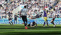 Pictured: Referee Chris Foy (L) the moment he got knocked over by a Fabricio Coloccini of Newcastle (C) deflection from a Jonjo Shelvey (4th L) shot of Swansea. Saturday 19 April 2014<br />