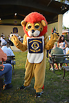 Port Washington, New York, U.S. - July 11, 2014 - In a lion mascot costume, a Port Washington Lions Club member greets visitors before the outdoor band concert at John Philips Sousa Memorial Band Shell, in Sunset Park in n the North Shore village on Long Island Gold Coast.