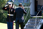 United States President Barack Obama salutes as he boards Marine One on the South Lawn of the White House in Washington, D.C., U.S., on Sunday, October 10, 2010. Obama is traveling to Philadelphia for a Democratic National Convention Rally.  .Credit: Joshua Roberts / Pool via CNP