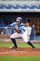 Charlotte Stone Crabs second baseman Kean Wong (4) lays down a bunt during a game against the Dunedin Blue Jays on July 26, 2015 at Charlotte Sports Park in Port Charlotte, Florida.  Charlotte defeated Dunedin 2-1 in ten innings.  (Mike Janes/Four Seam Images)