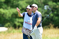 Bethesda, MD - July 1, 2018: Francesco Molinari talks with his Caddy before teeing off at hole 2 during final round of professional play at the Quicken Loans National Tournament at TPC Potomac at Avenel Farm in Bethesda, MD.  (Photo by Phillip Peters/Media Images International)