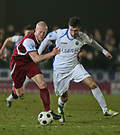 Picture by David Horn/Extreme Aperture Photography +44 7545 970036.18/02/2013.Kenny Clark (capt) of Chelmsford City and Ollie Palmer of Havant & Waterville contest the ball during the Blue Square Bet Blue Square South  League match at Melbourne Stadium, Chelmsford, Essex.