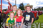 Jack, Diarmuid Óg and Caoimhe O'Connor from Moyvane with Lee Harbour from Glin pictured last Sunday at the annual Knockdown Vintage Rally.