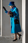 © Joel Goodman - 07973 332324 . No syndication permitted . 14/11/2013 . Manchester , UK . The Queen waves to crowds as she leaves . Queen Elizabeth II and the Duke of Edinburgh visit the Coop building at 1 Angel Square , Manchester , this morning ( 14th November 2013 ) . Photo credit : Joel Goodman