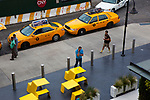 Yellow cabs and yellow seats, seen from the High Line. The High Line is a 2.33 km elevated linear park, greenway and rail trail following the path of railway on Manhattan's West Side in New York City.