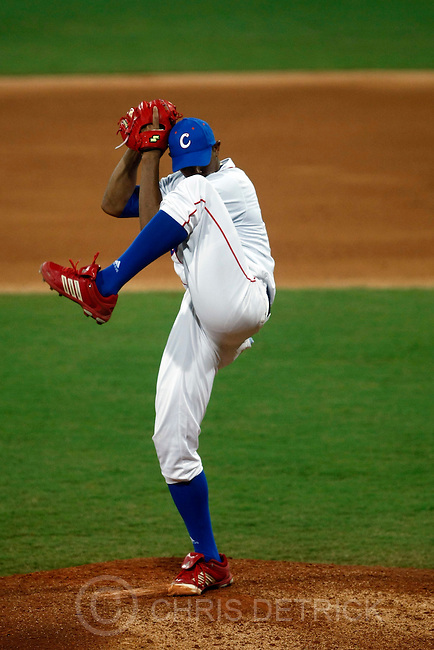 Cuba's Norge Luis Vera delivers a pitch during the semifinals game at the Wukesong Baseball Field in Beijing, Friday, August 22, 2008.  Cuba won the game 10-2..Chris Detrick/The Salt Lake Tribune.