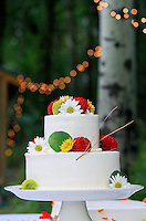 A beautiful wedding cake finds a home amongst the georgeous trees in the Methow Valley. (Photo by Dan DeLong).