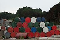 Landscape view of a stack of oil barrels near Route 45 following the 311 Tohoku Tsunami in Minamisanriku, Japan  © LAN