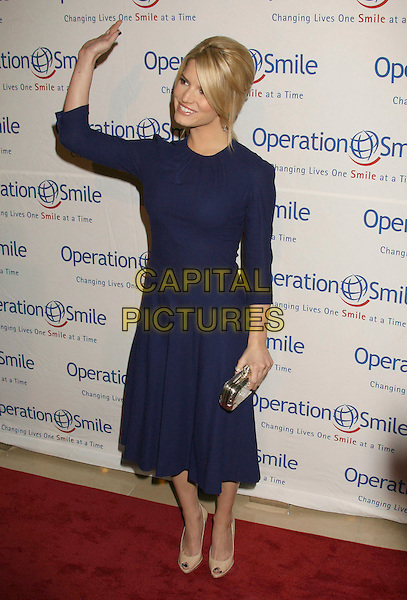 "JESSICA SIMPSON.25th Annual ""Operation Smile"" Benefit Gala held at the Beverly Hills Hotel, Beverly Hills, California, USA, .5 October 2007..full length blue dress hand waving beige patent shoes.CAP/ADM/RE.©Russ Elliot/AdMedia/Capital Pictures."