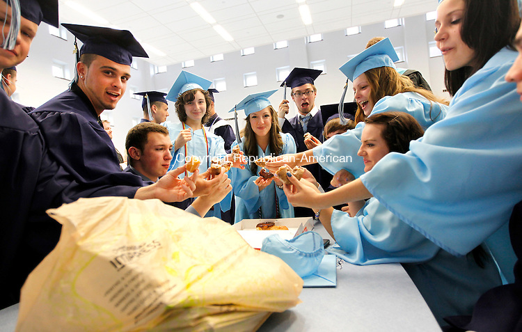Oxford, CT- 23, June 2011-062311CM04  Oxford High School graduates from math teacher, Ken Seder's advisory class, eat donuts before the start of graduation ceremonies in Oxford Thursday night.  Christopher Massa Republican-American