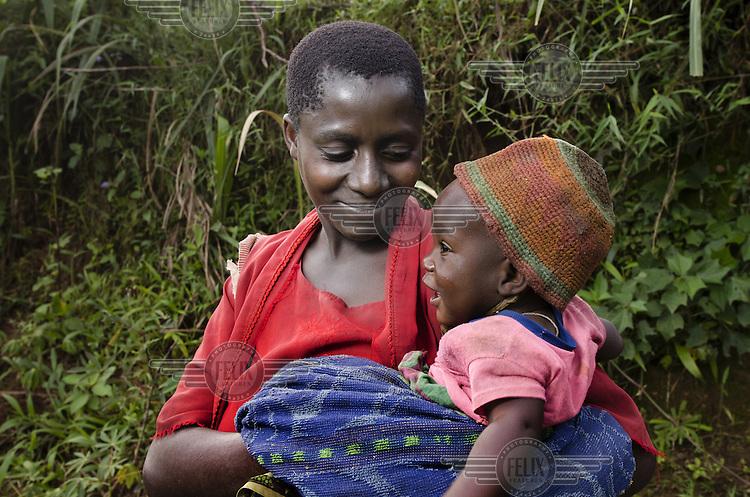 Leocadia Mbwiruwumva with her baby Gloriose Ntirambeb in the Mabayi Commune in Ruhororo Colline.