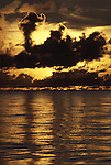 Sunrise breaks through the clouds in the Western Pacific Ocean off the coast of Naru. (Jim Bryant Photo).....