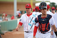 Florida Fire Frogs starting pitcher Bryse Wilson (20) walks to the dugout with catcher Brett Cumberland before a game against the Daytona Tortugas on April 7, 2018 at Osceola County Stadium in Kissimmee, Florida.  Daytona defeated Florida 4-3 in a six inning rain shortened game.  (Mike Janes/Four Seam Images)