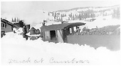 Locomotive in snow drift at Cumbres station.<br /> D&amp;RGW  Cumbres, CO