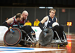 Qld's Michael Ozanne and Chris Bond work as a team to chase down Victoria's Josh Hose during the gold medal match of the National Wheelchair Rugby Championships 2013 <br />