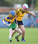 Erica Wynne of Inagh/Cloonanaha in action against Ellie Ward of Clonlara during their Schools Division 1 final at Cusack Park. Photograph by John Kelly