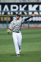 Christian Marrero (24) of the Birmingham Barons warms up in the outfield prior to the game against the Tennessee Smokies at Regions Field on May 3, 2015 in Birmingham, Alabama.  The Smokies defeated the Barons 3-0.  (Brian Westerholt/Four Seam Images)