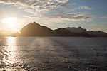 Midnight sun low in sky over mountains near Stamsund, Lofoten Islands, Nordland, Norway